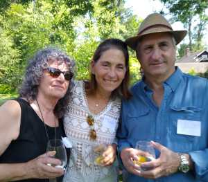 Founder, board member and guest enjoy Recovery Kitchen garden party