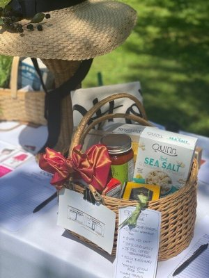 Silent auction basket at Recovery Kitchen garden party
